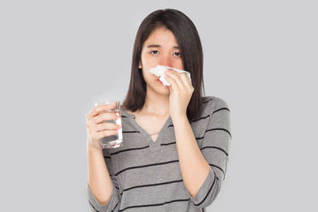 young asian woman feel have fever and sick