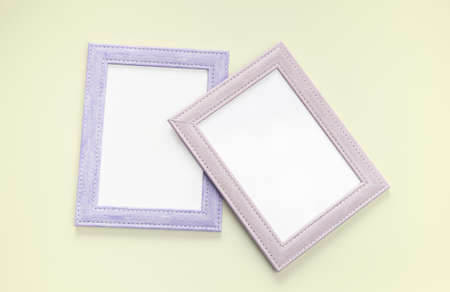 flat lay purple color picture frame on yellow pastel floor background Stok Fotoğraf