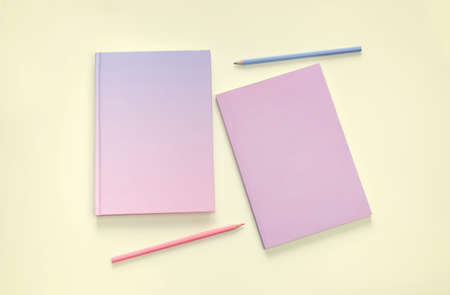 flat lay purple color book stationery and blue pencil on yellow floor background