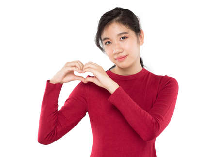 young asian women show pose love symbol and concern Stock fotó
