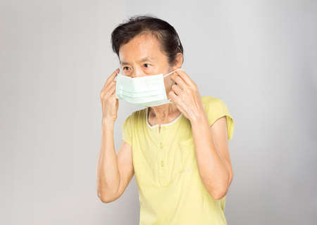 old asian woman wearing mask to prevent the virus