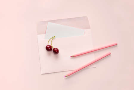 flat lay pink letter and pencil stationery on pink background Stock fotó