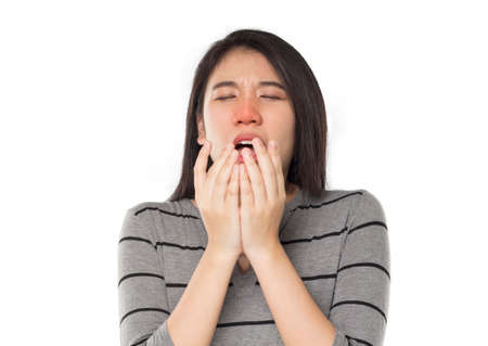 young asian woman sneeze feel sick in white background