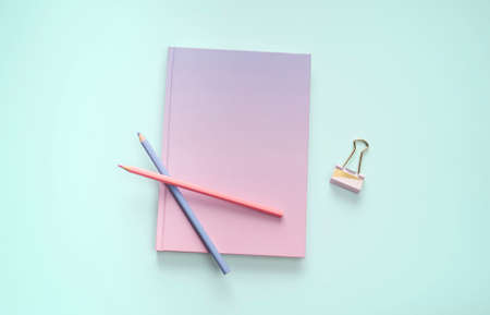 flat lay book stationery and pencil in green mint backgroung