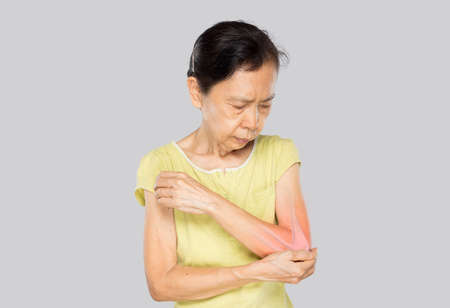 old asian woman feel elbow bones injury Stock fotó