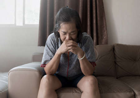 asian woman suffering from mental health feel sad in home Stok Fotoğraf