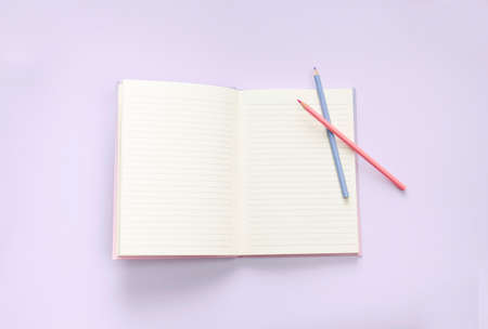 flat lay book and stationery on purple pastel floor Stok Fotoğraf