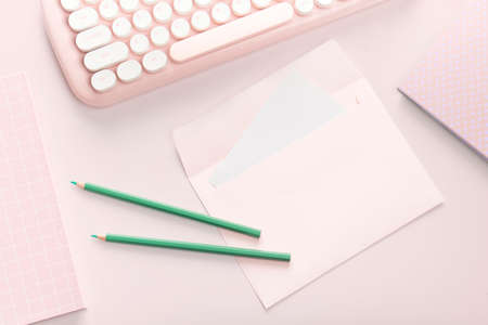 flat lay pink color envelope and stationery on pink pastel floor background Stok Fotoğraf