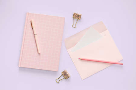 flat lay pink color envelope and stationery on purple pastel floor background Stok Fotoğraf