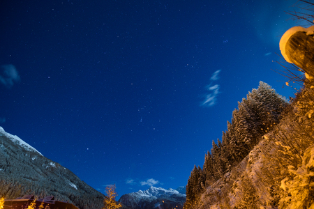 Cleary night sky in the alps with full moon during winter Stock Photo