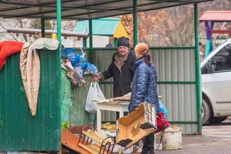 beggars: Zhytomyr, Ukraine - February 23, 2016: Beggars seeking for something useful Editorial