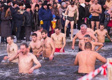 baptize: Zhytomyr, Ukraine - January 19, 2016: People celebrating epiphany at winter water