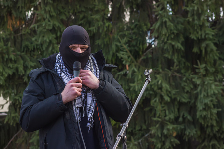 extremist: Zhytomyr, Ukraine - February 12, 2016: Extremist talking on microphone