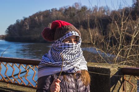 extremist: Zhytomyr, Ukraine - February 17, 2016: Girl extremist at river ready for fight Editorial
