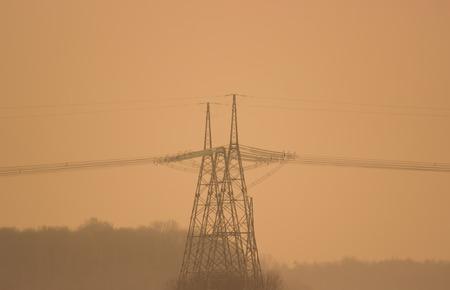 megawatts: High voltage power line on the fog