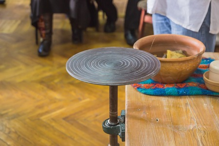 dexterity: Machine pottery on the unusual table ready for art Stock Photo