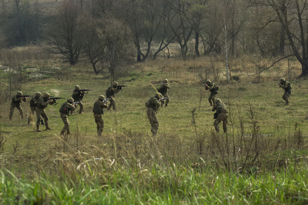 sniper training: Military soldiers at tactical exercises with guns Stock Photo