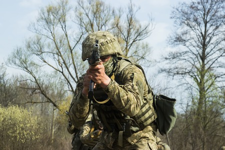 tactical: Military soldiers at tactical exercises with guns Stock Photo