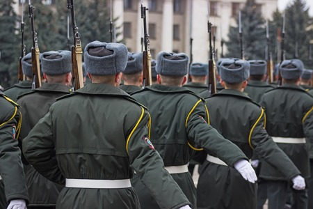 mobilization: Military in the green dress uniform standing with his back to the viewer