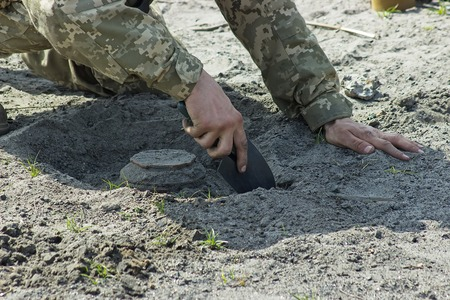 tactical: Military soldiers at tactical exercises with mine