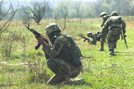 Military soldiers at tactical exercises with guns Stock Photo