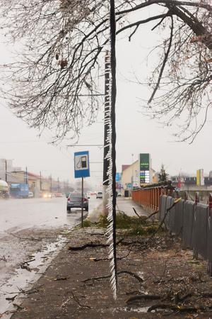 ice storm: Power pole broken in street ice storm Stock Photo
