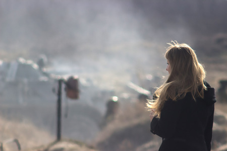 Girl at burning war field