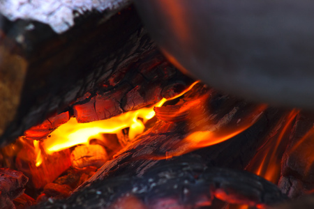 woodburner: big red burning logs at fire place Stock Photo