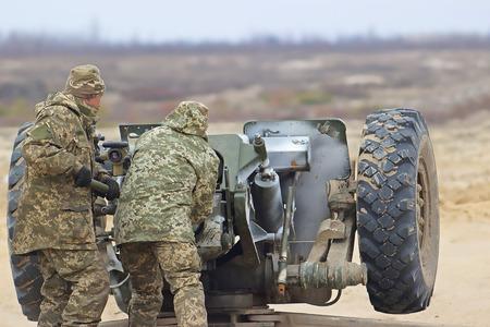 firepower: Heavy artillery gun on military at war