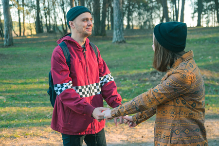 sluttish: two happy homeless man and woman hold hands each other in the evening