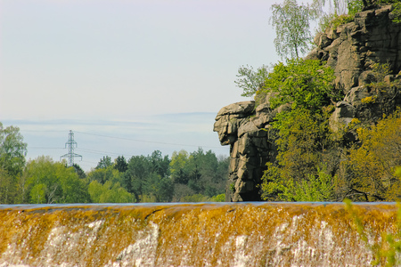 Monumental god head near dry river dam on mount Chatskogo, Ukraine