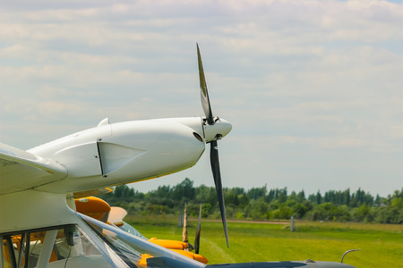 Yellow plane propeller turns at the airport