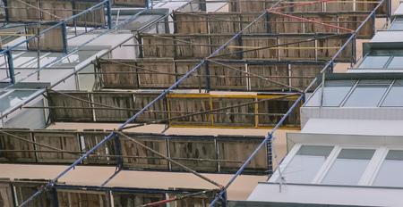 hoists: Building house under construction against blue sky