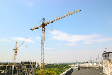 hoists: Partially built residential housing building site with homes in early stages of construction