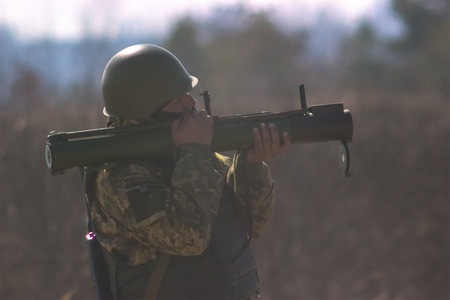 guerilla: Zhytomyr, Ukraine - March 5, 2015: Military soldiers at tactical exercises with guns