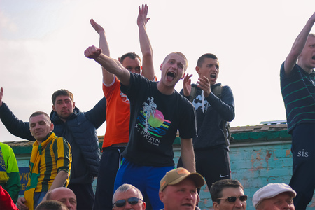 Zhytomyr, UKRAINE - May 21, 2017: Football angry fans soccer game in an open field Editorial