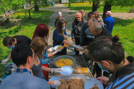 Zhytomyr, UKRAINE - May 21, 2017: Some anarchist activists at Food Not Bombs campaign feeding the homeless in Zhytomyr