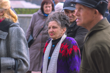 law of portugal: Zhytomyr, Ukraine - SEPTEMBER 15, 2015: Old woman protesting against government against tax growth