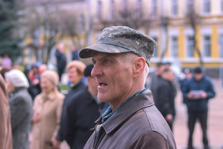 Zhytomyr, Ukraine - SEPTEMBER 15, 2015: Old man protesting against government against tax growth Editorial