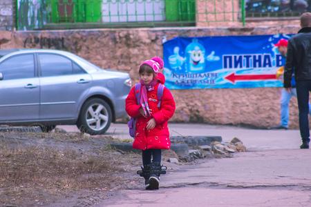 Zhytomyr, Ukraine - September 03, 2015: Young kids return home from school at Mala Berdychivska street Editorial