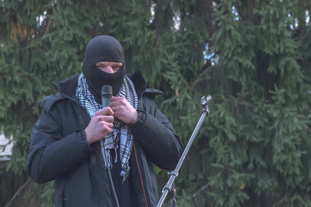 Zhytomyr, Ukraine - February 12, 2016 Extremist talking on microphone