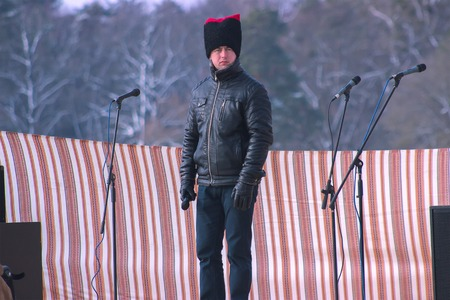 Zhytomyr, Ukraine - May 05, 2015: man with fun hat and microphone on the scene