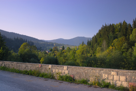 view on mountains at edge of medieval castle stone wall