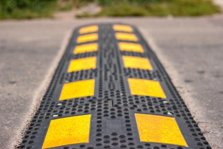 big yellow asphalt policeman on the road