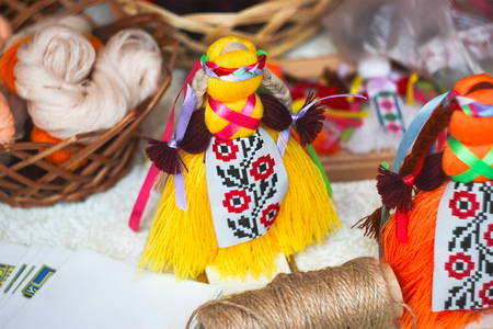 traditional Ukrainian folk doll motanka on table