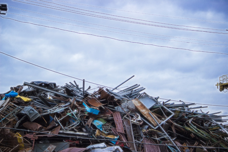 Recycling industry. Business Recycling. Metal Scrap at dark sky Stock Photo