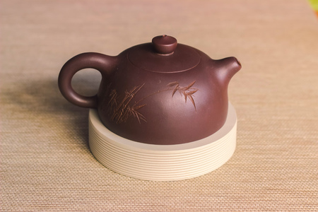 tea in cast-iron teapot on wooden background