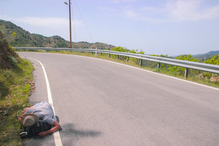 Drunk Man Sleeps on the edge of highway