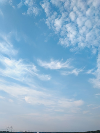 cloudscape with white altocumulus clouds in the evening Stock Photo