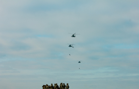 Military Army paratroopers display at air show festival.